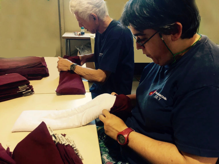 Maria, one of our workers putting covers on the pillows